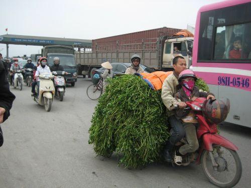 busy street vietnam traffic people riding motorbikes