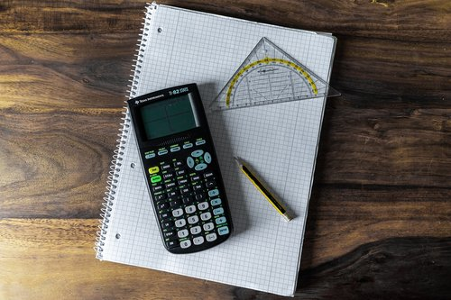 calculator  writing pad  school