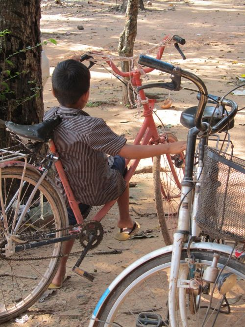 cambodia child bicycle