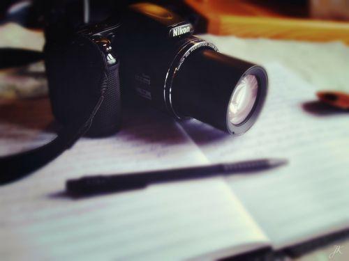 fotoaparatas,rašiklis,dienoraštis