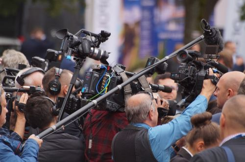 camera crowd group