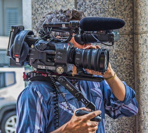 camera  cameraman  man