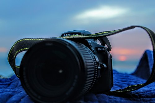 camera  strap  sunset