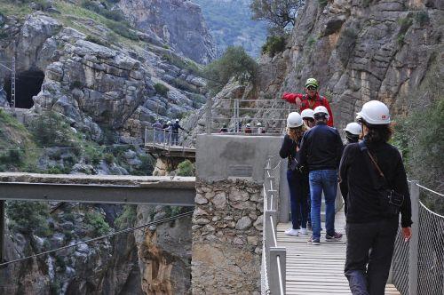Caminito del Rey,Malaga,nuotykis,aktyvus turizmas,aukštis,turizmas,vartai,Andalūzija,turistai,kalnas,ekskursija,gamta,siena,turizmo produktas,tiltas