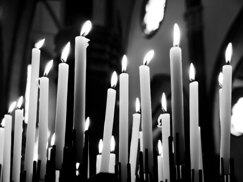 candles prayers black and white