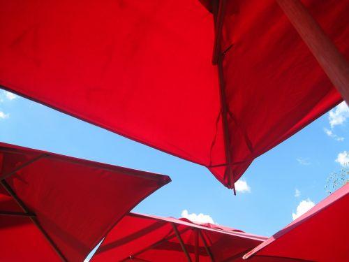 Canopies Of Red Umbrellas