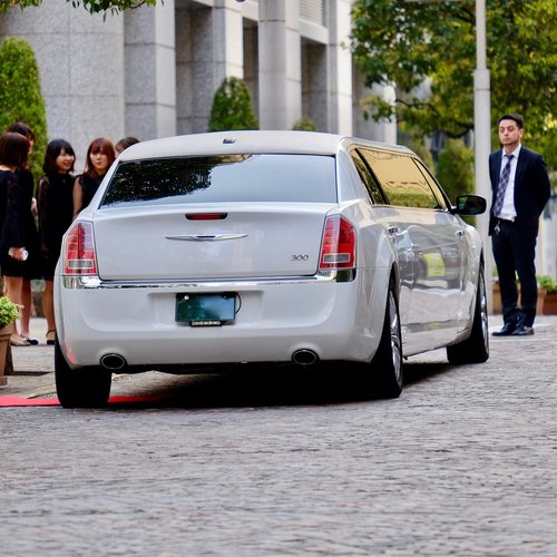 car white  long  limousine