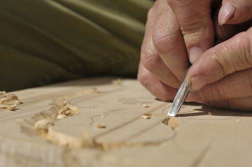 carpenter  sculpting  wood