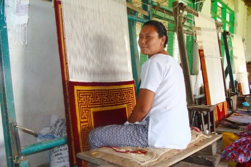 carpet weaving tibetan lady