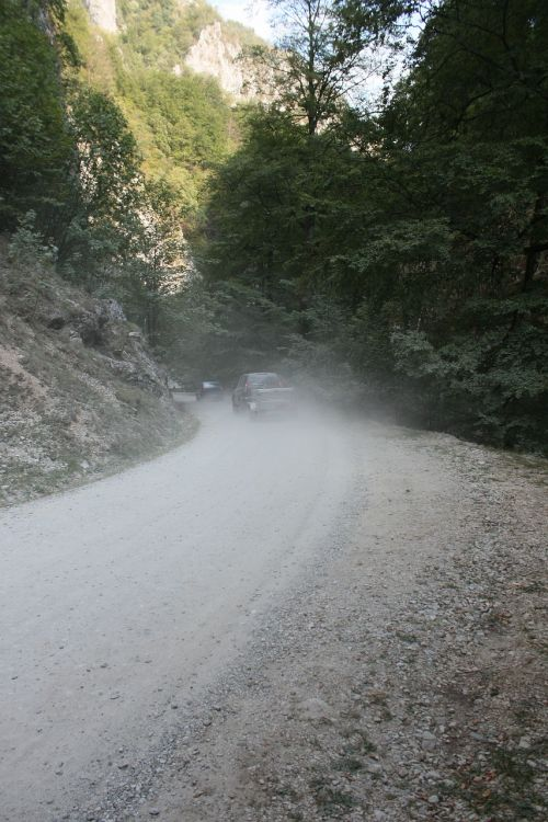 cars dust gravel