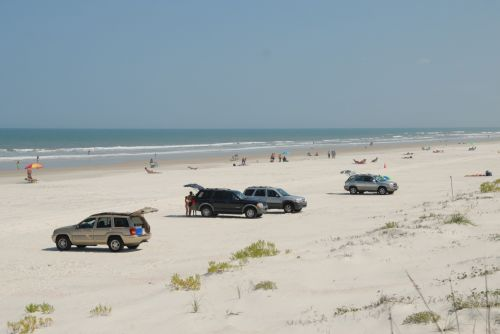 Cars Parked On The Beach