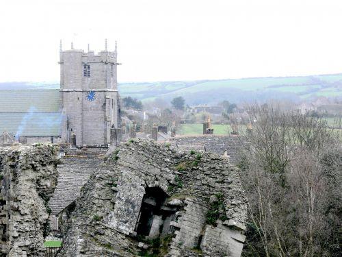 Castle Ruins And Church Clock