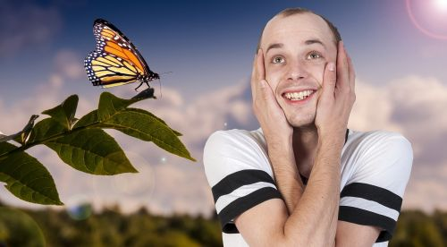 caucasian,male,is,excited,about,summertime,butterfly