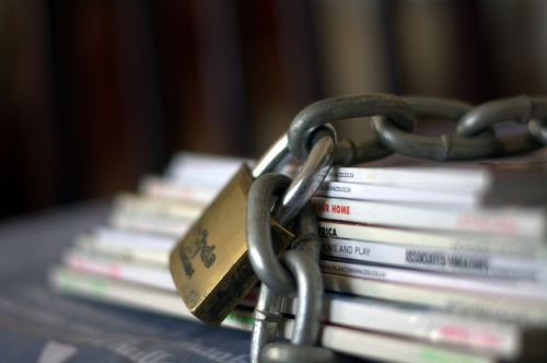 chained magazines paper safe