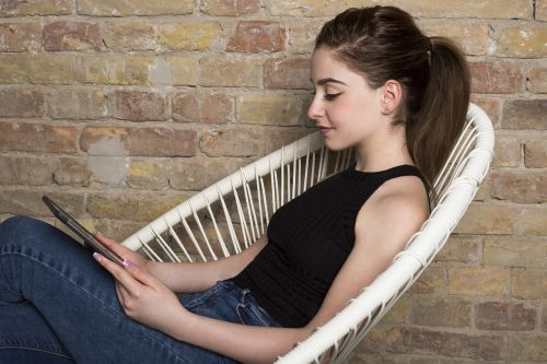 chair tablet pc girl