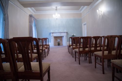 Chair Sits In An Empty Room