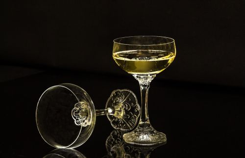 champagne glasses a full glass an empty glass