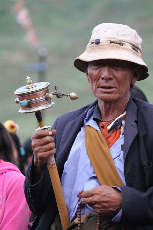 character turning the wheel tibet ethnic
