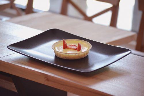 cheesecake with strawberry plated dessert delicatessen