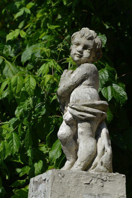 cherub statue greenery
