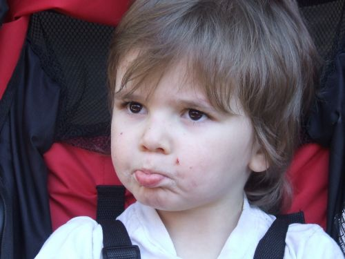 child face pouting