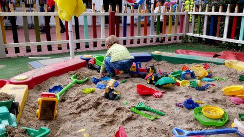 child sand pit play