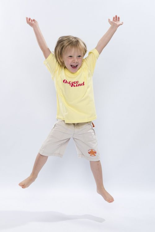 child jumps laughing