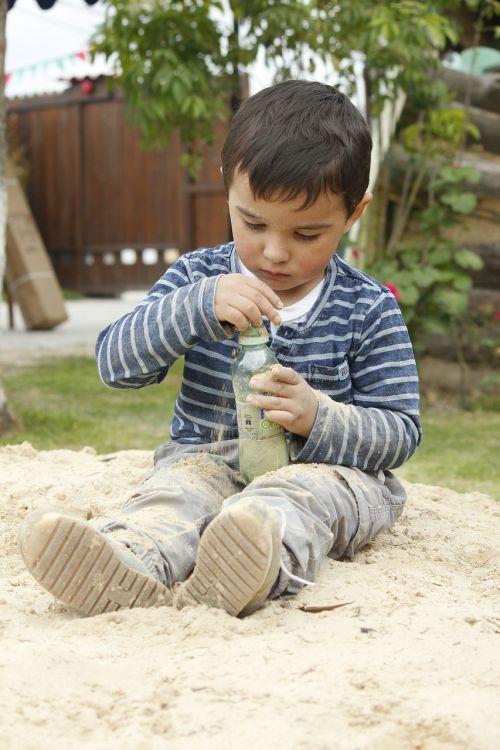 child playing arenero
