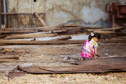 child  girl  rubble