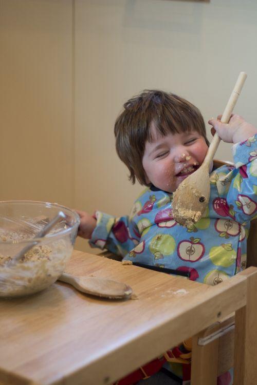 child cake making licking
