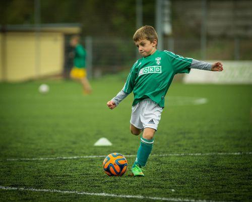 child footballer kick