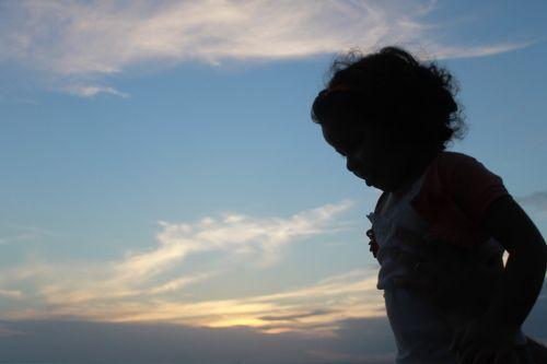 child silhouette sunset