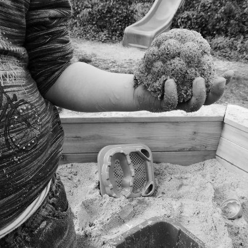 child hand sand