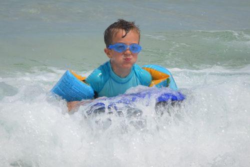 child waves surf