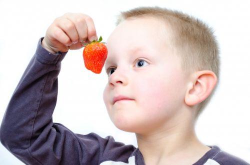 Child And Strawberries