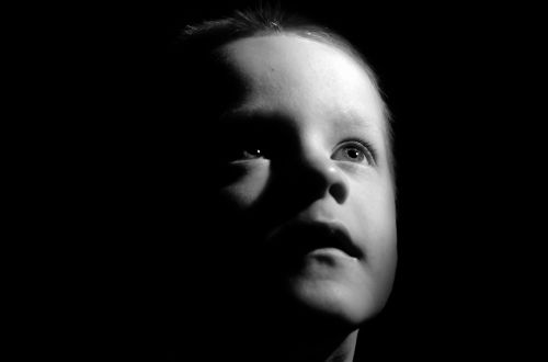 Child Face In Shadow