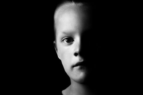 Child's Face In The Shade