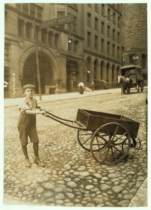 child labor boy carriage