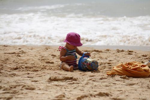 child playing beach bucket