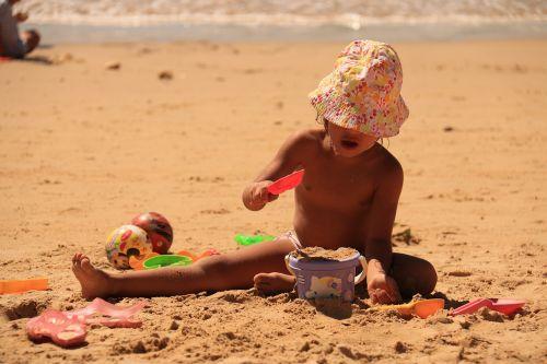 child playing sand beach
