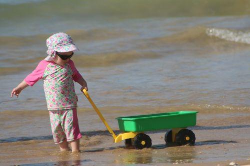 child playing beach children playing