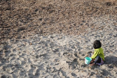 child playing in sand little girl girl