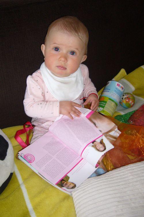 Child Reading Magazine