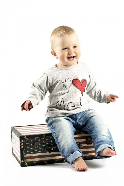 Child Sitting On The Suitcase