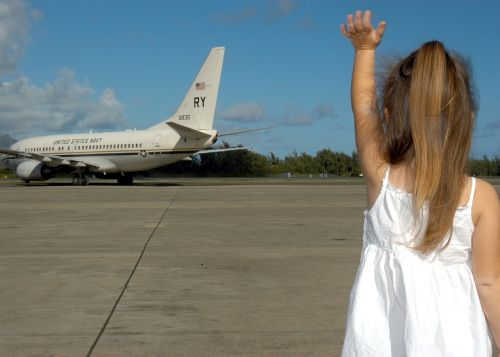 child waving goodbye departure plane