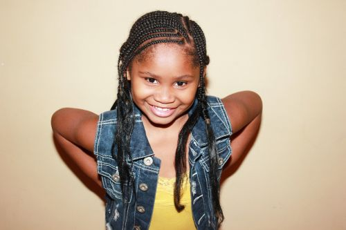 child with braids braids african american girl