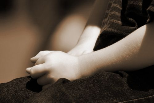 Child With Hands In Lap