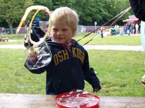 children soap bubbles play outside