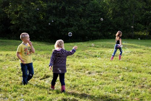 children playing soap bubbles
