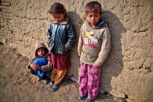 children poor mud village